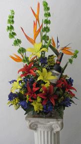 Centro con lirios y vino 150.000 180.000 230 Enviar Flores a Domicilio