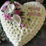 Corazon funebre en pompon rosas y anturios. 140.000 180.000 220.000 190x190 Tienda